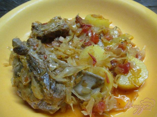 фото рецепта: Свиные ребра с квашенной капустой