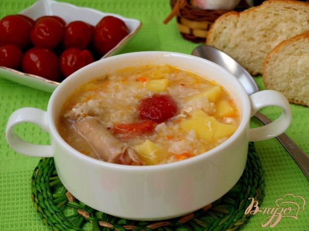 фото рецепта: Куриный суп с рисом и маринованными помидорами
