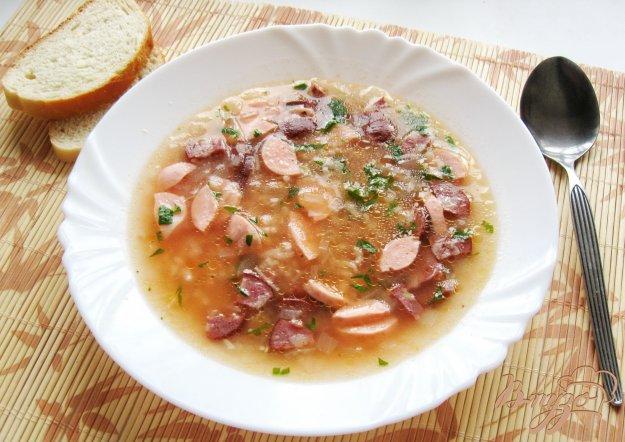 фото рецепта: Рисовый суп с колбасой и сосисками