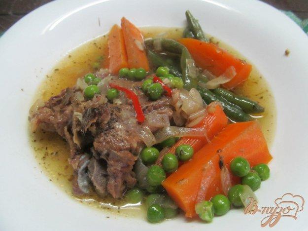 фото рецепта: Тушеная говядина с морковью и горошком