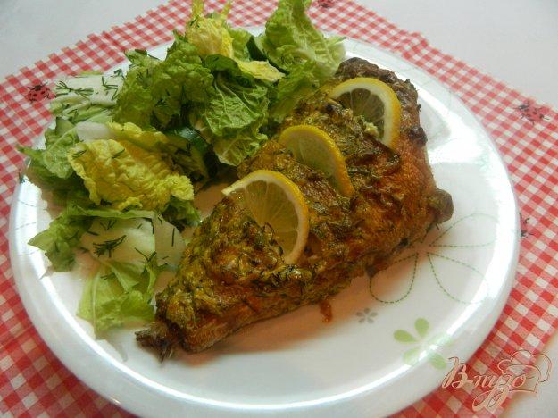 фото рецепта: Морской окунь запеченный  под чесночным соусом