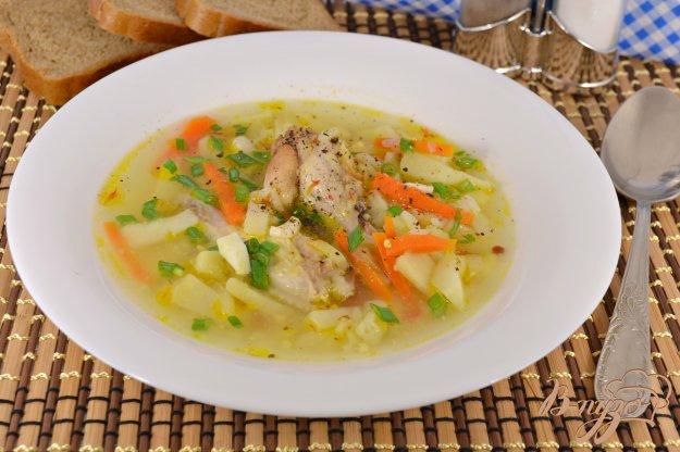 фото рецепта: Суп с куриными крылышками, рисом и яйцом