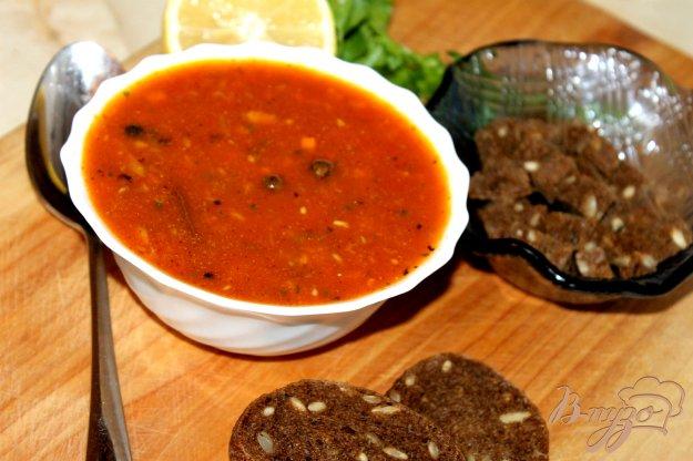 фото рецепта: Томатный суп с рыбой и кинзой