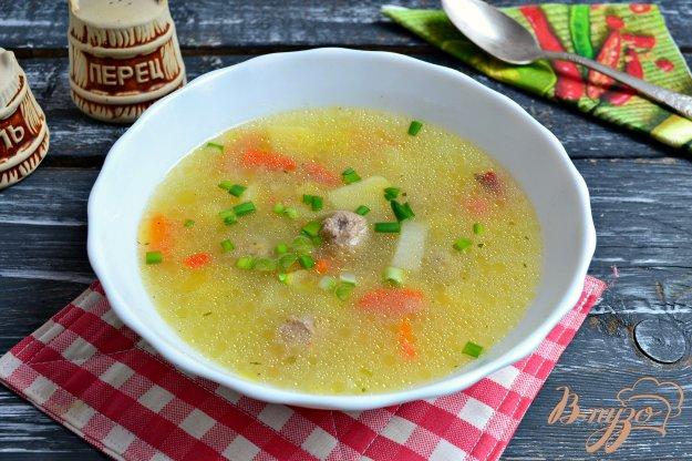 фото рецепта: Овощной суп с рисом и свиными фрикадельками