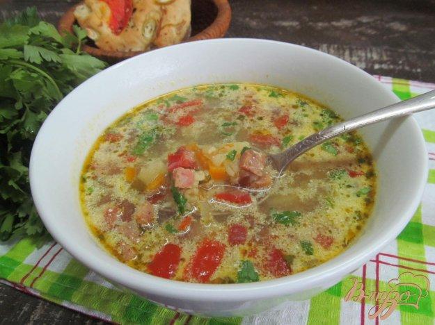 фото рецепта: Суп с малосольным огурцом беконом и булгуром