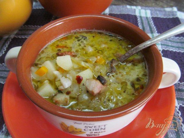 фото рецепта: Суп с маринованной капустой и грибами