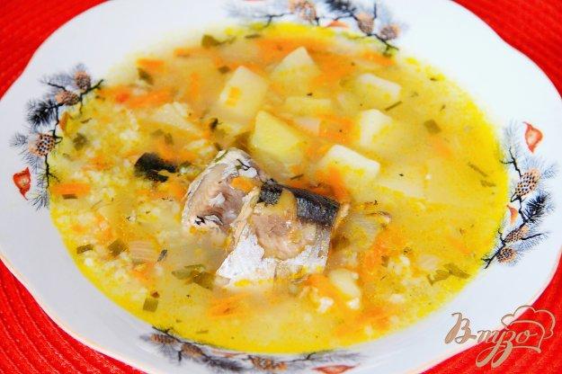 фото рецепта: Суп с рыбной консервой и рисом в мультиварке