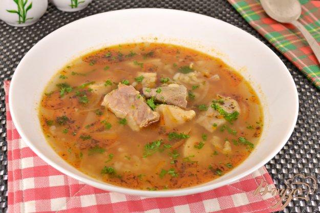 фото рецепта: Острый суп с курицей, свининой и рисом