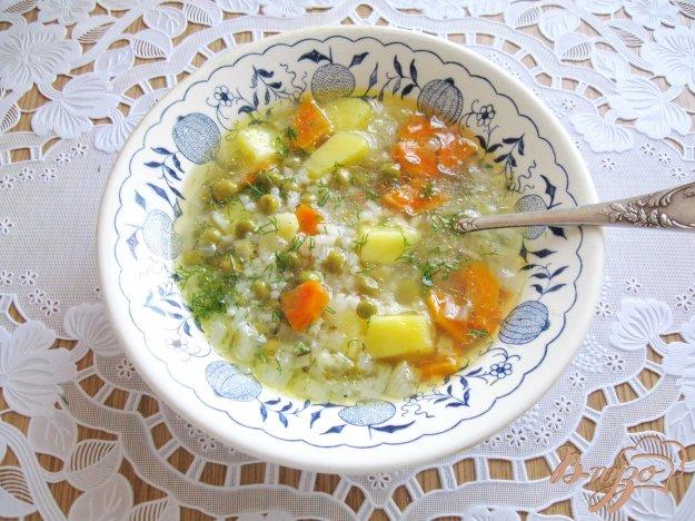 фото рецепта: Суп с рисом и зеленым горошком