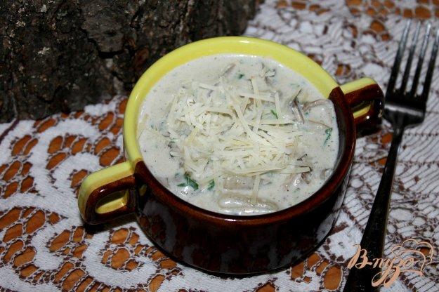 фото рецепта: Кальмары тушеные с шампиньонами и вешенками в сливочном соусе
