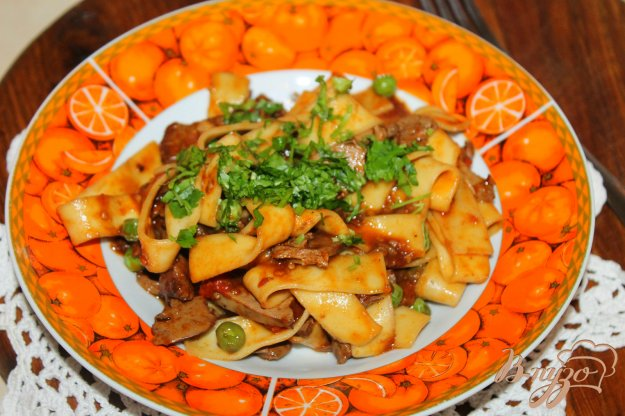 фото рецепта: Макароны с куриной печенью и зеленым горошком