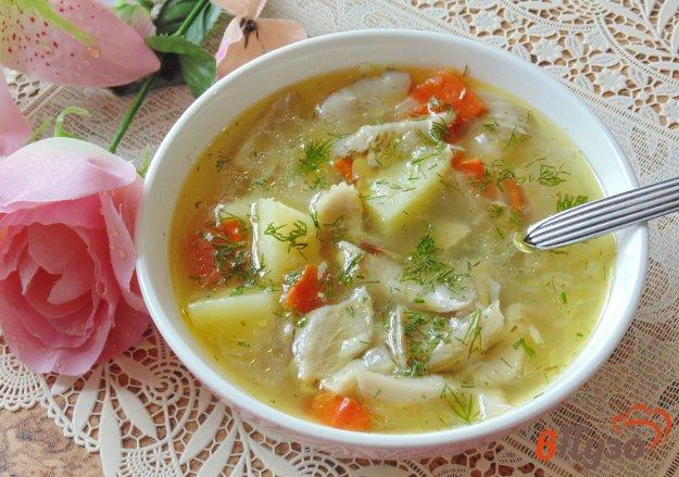 фото рецепта: Рисовый суп с грибами и чесноком