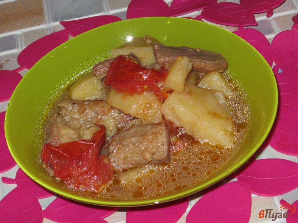 Фото приготовление рецепта: Рагу из говядины с картофелем и помидорами шаг №9