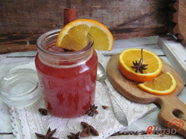 фото рецепта: Горячий напиток из клюквы с апельсином
