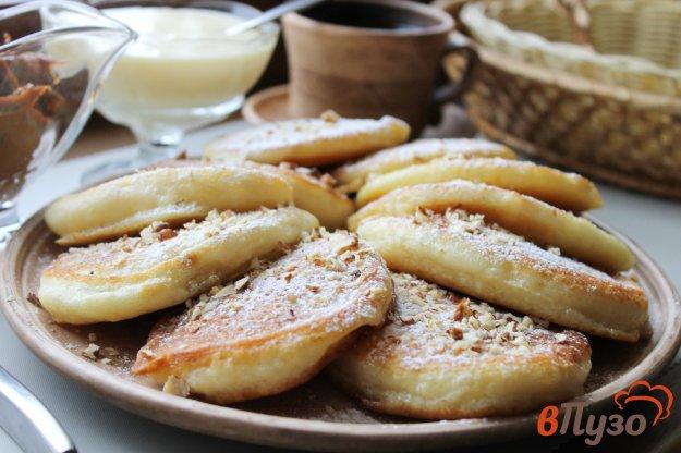 фото рецепта: Ванильные оладьи со сгущенкой и орешками
