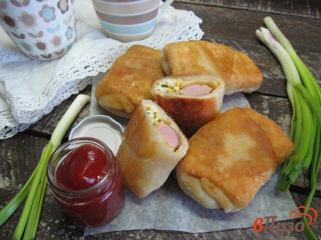 фото рецепта: Пирожки с сосисками и яйцом