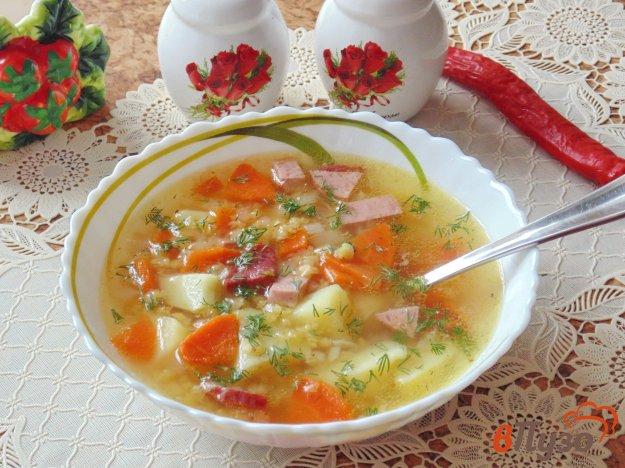 фото рецепта: Суп с красной чечевицей и копченой колбасой