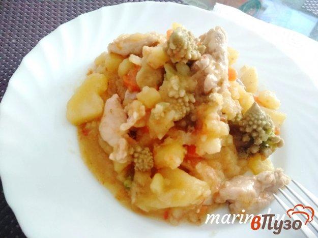 фото рецепта: Тушеная куриная мякоть с овощами