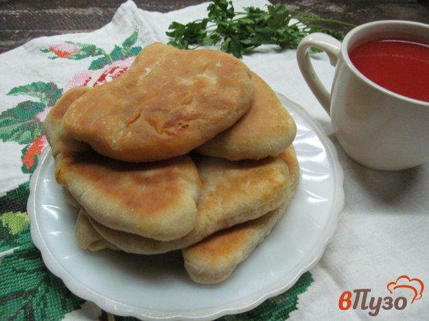 фото рецепта: Пирожки на кефире с капустой
