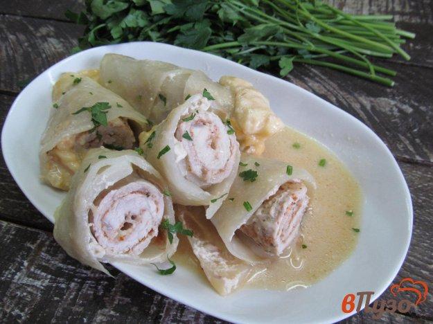 фото рецепта: Свиные отбивные в капусте