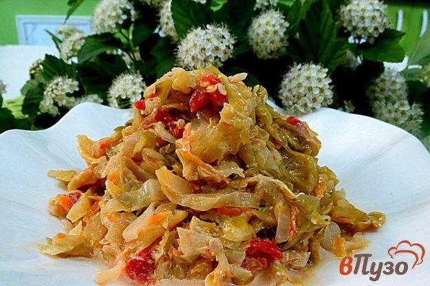 фото рецепта: Тушёная капуста с помидорами и сметаной
