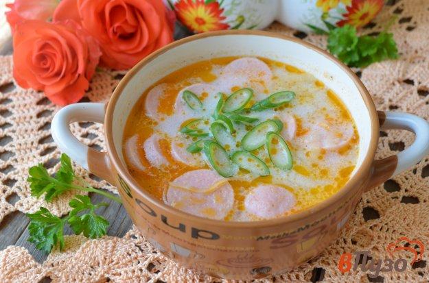 фото рецепта: Суп с квашеной капустой и сосисками