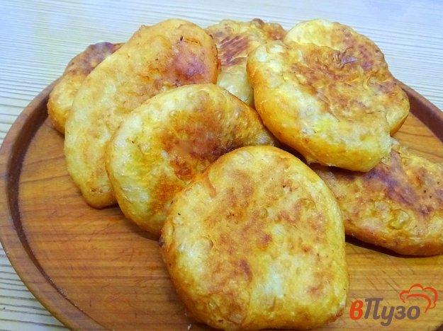 фото рецепта: Пирожки дрожжевые с картошкой (жареные).