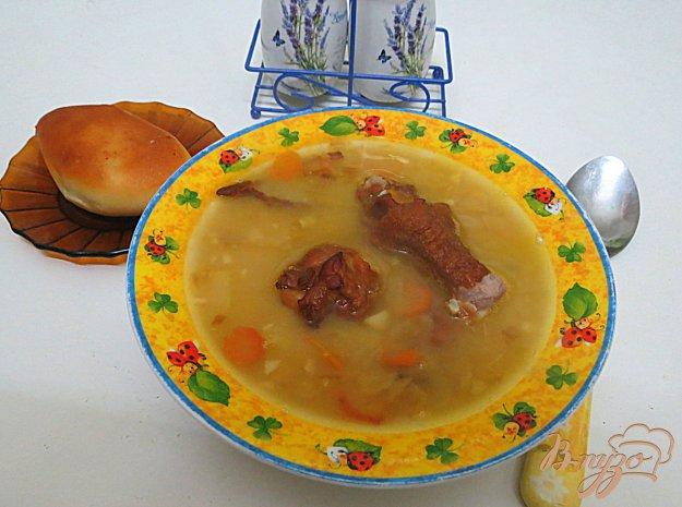 фото рецепта: Гороховый суп с копчёными крылышками